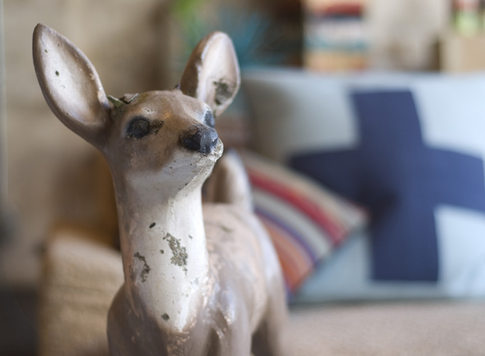 One of Lauderdale's prized deer garden statues, in front of his Pendleton Home Store pillows.