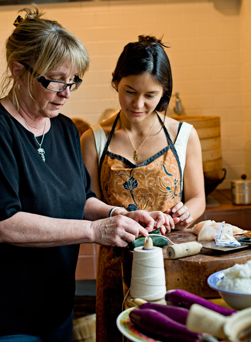 Julie and her daughter, Sheila Scrobogna cook together in the Chinese kitchen.