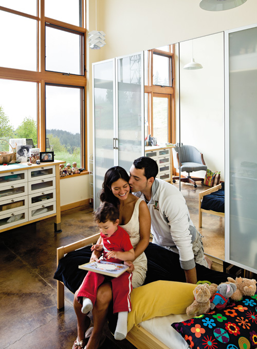 Daughter Sheila with her husband and son in a bedroom designed just for kids.