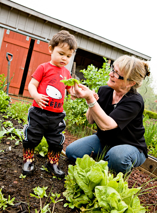 Julie shows Daniel some of her garden's bounty.