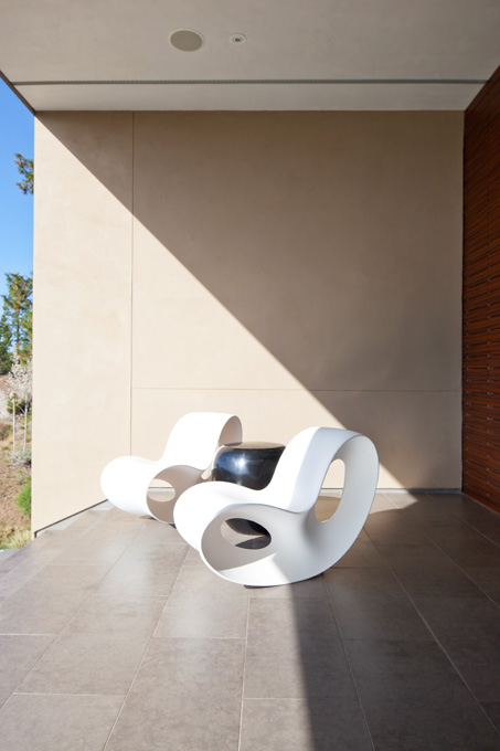 White Voido chairs by Magis provide stylish seating off the formal living room..