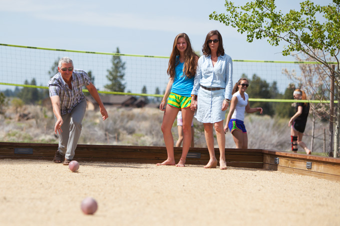 "Keith Kenneally takes his turn watched by daughter Reneé and his wife, Deanne, while his older daughter, Andie, plays volleyball with her Summit High ""Storm\"" teammates."