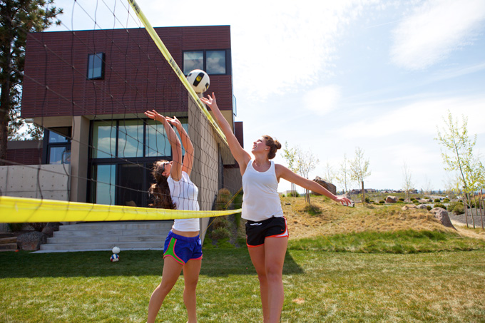 Andie Kenneally (left) and Taylor Pierce work on their net game.