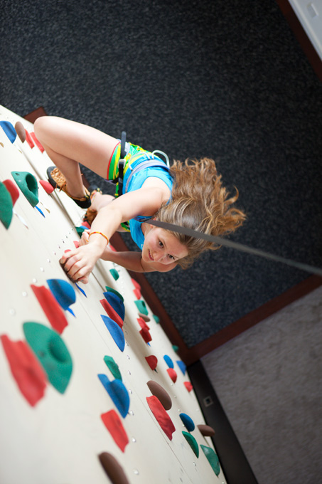 Reneé Kenneally scales the 16-foot climbing wall that leads to her bedroom.