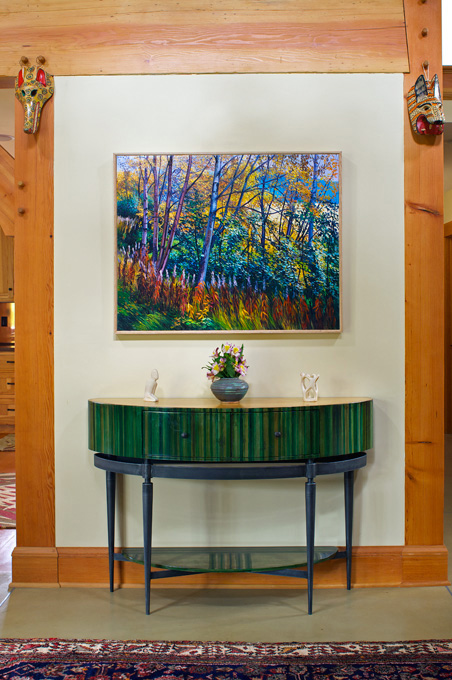 Colorful art and furniture grace the hallway.