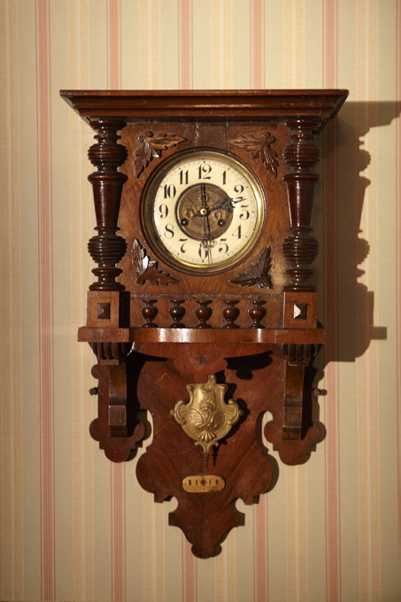 Every clock in the house is set to a different time; a little irony in the clock repairman's house. Faded striped wallpaper, dingy colors and dim lighting make the set feel like a bad dream you can't quite wake from.