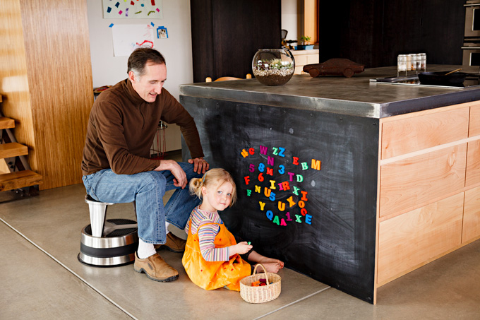 Tim Gift and his daughter, Ada, at her magnetic ABC board.
