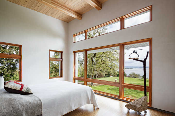 The master bedroom on the second floor is open to nature and light.