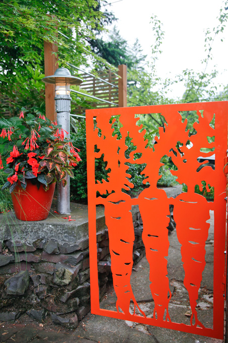 A vibrant and whimsical gates leads to the back yard.