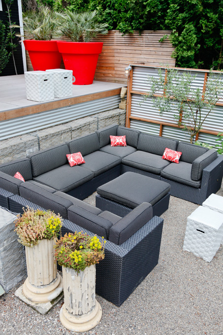 The gray cushions allow for all-weather durability and a neutral background .