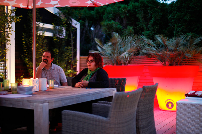 Jose and JJ De Sousa linger at twilight in their outdoor living room.