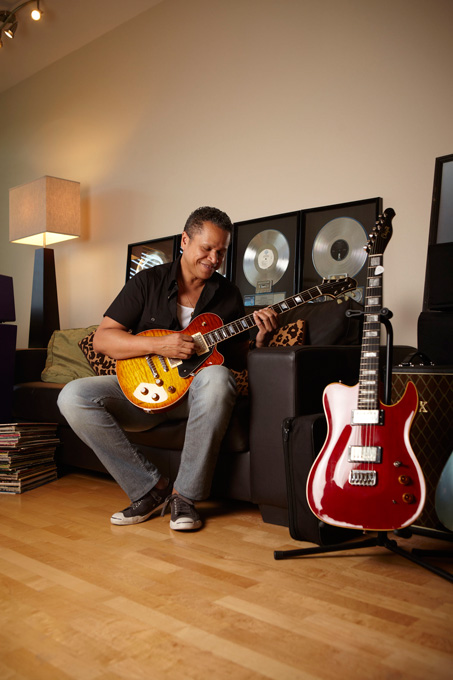 Handmade guitars, collectible amplifiers and framed gold and platinum albums make the best accessories. That and a black leather sofa is about all Eddie Martinez needs in his man cave/home office in the old Multnomah Village neighborhood in Portland.