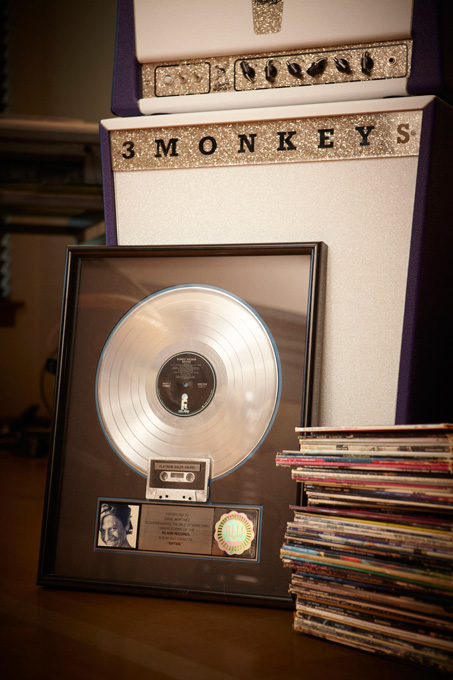 "A collection of vinyl, a glitzy 3 Monkeys Amps and a framed platinum album commemorating more than a million sales of Robert Palmer's ""Riptide\"" on which Eddie Martinez, now of Portland, played guitar."